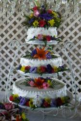 Garden stand with silks wedding cake