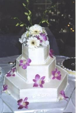 Smooth buttercream hexagon wedding cake